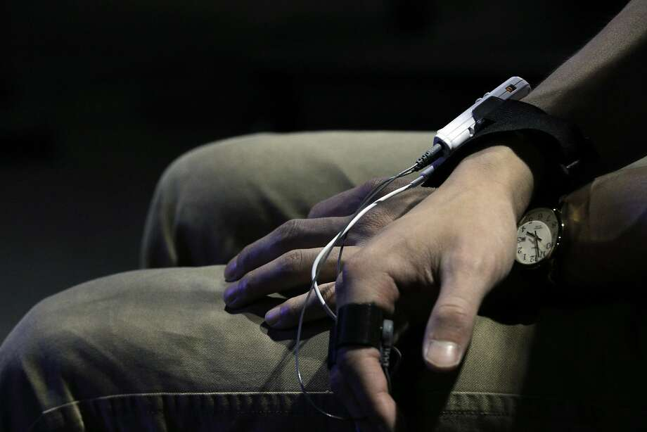 Dolby scientist Evan Gitterman watches a film while having his biological responses monitored with pulse and GSR sensors in the Biophysical Lab at the Dolby Laboratories in San Francisco, Calif., on Tuesday, September 27, 2016. Photo: Carlos Avila Gonzalez, The Chronicle