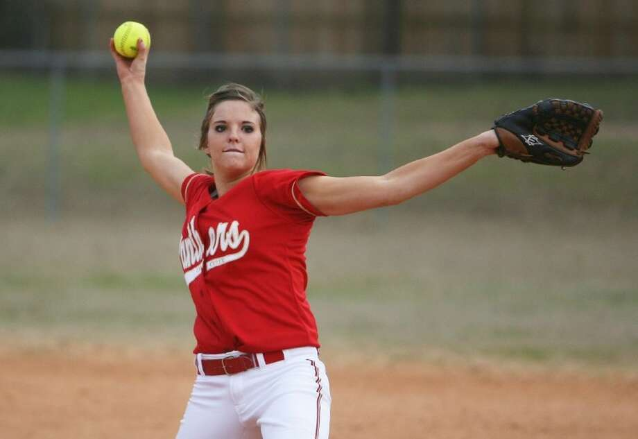 Caney Creek's Laci Belovsky, pictured above pitching against SATCH at the Ladykat Softball Tournament in Willis earlier this season, earned the win against Humble on Wednesday night.