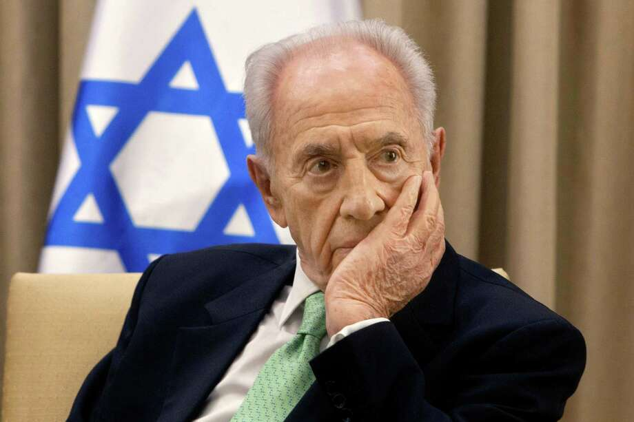 Israel's Shimon Peres was awarded the Nobel Peace Prize for his key role in achieving the first Israel-Palestinian peace accord. Photo: Sebastian Scheiner, STF / Copyright 2016 The Associated Press. All rights reserved.