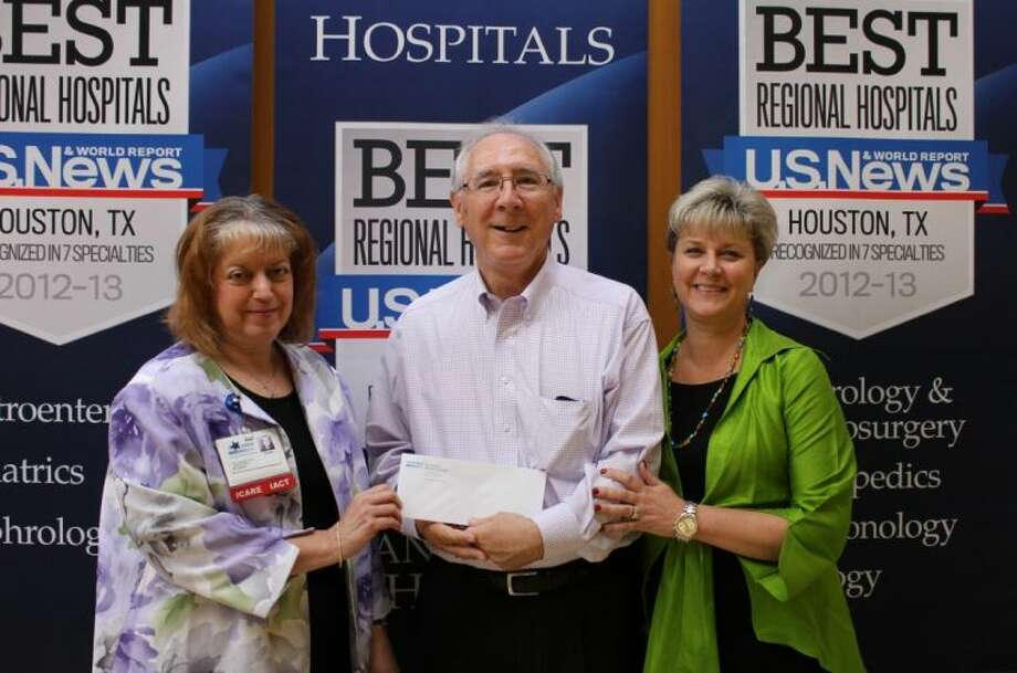 Receiving the check on behalf of Bay Area Homeless Services is Bill Eckert (center), Executive Director,. Donna Gares (left), president and CEO and Laurie Terry (right), Vice President, present the check on behalf of San Jacinto Methodist Hospital.