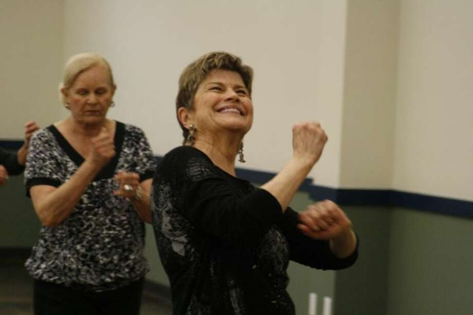 Seniors learn new line dances as part of one of the programs at the Kingwood Community Center.