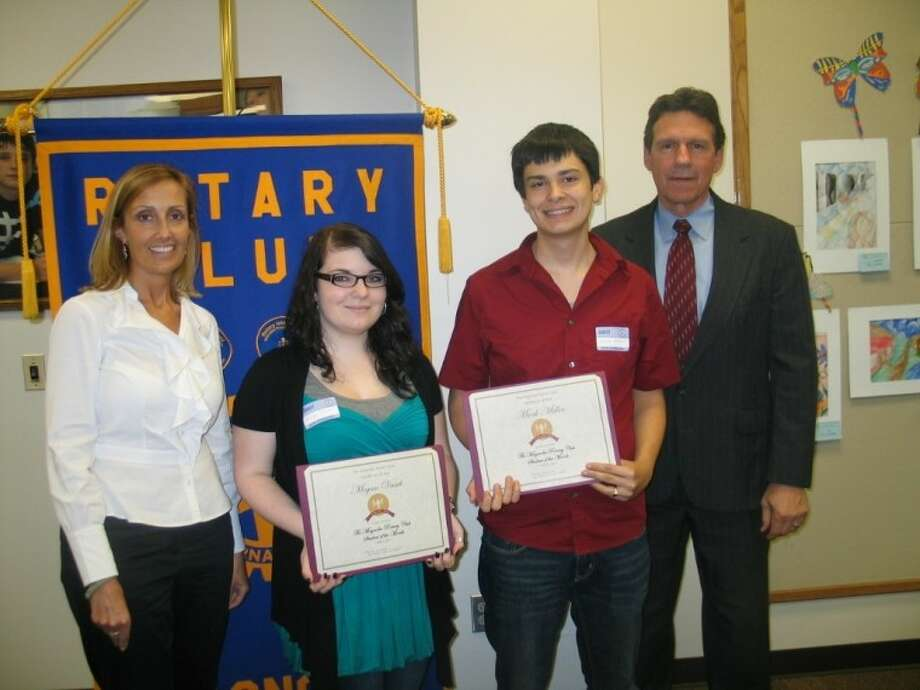 Two students from ALPHA Academy were honored as Students of the Month, during a March 8 Rotary Club of Magnolia meeting. The students are now eligible to apply for Rotary Scholarships at the end of the year. Left to right: Former Rotary President Judy Bode, Megan Vasek, Mark Miller and ALPHA Academy Principal Keith Doehrmann. The Rotary Club of Magnolia meets Tuesdays at noon at the Celeste Graves building located on Nichols Sawmill Road. There will be no meeting for next week on March 15.