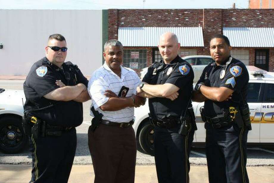 Officer James Barrie, Assistant Chief Patrick Christian, Officer Noel Shelton and Sgt. Howard Sylve and their fellow officers of the Hempstead Police Department will begin enforcing seat belt use in motor vehicles on May 18 as part of the state-wide Click-it or Ticket campaign.