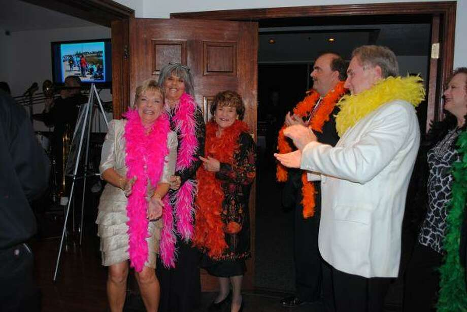 Seabrook Association President Marcy Fryday, center, joins Pelican Ball Chairman Jenny Arunyon, from left, Co-Chairman Patty Kane, Mark Renza and Tom Diegelman in leading the Pelican Promenade at the Seabrook Association's inaugural Pelican Ball Friday night in the Endeavour Marina's Admiral Ballroom.