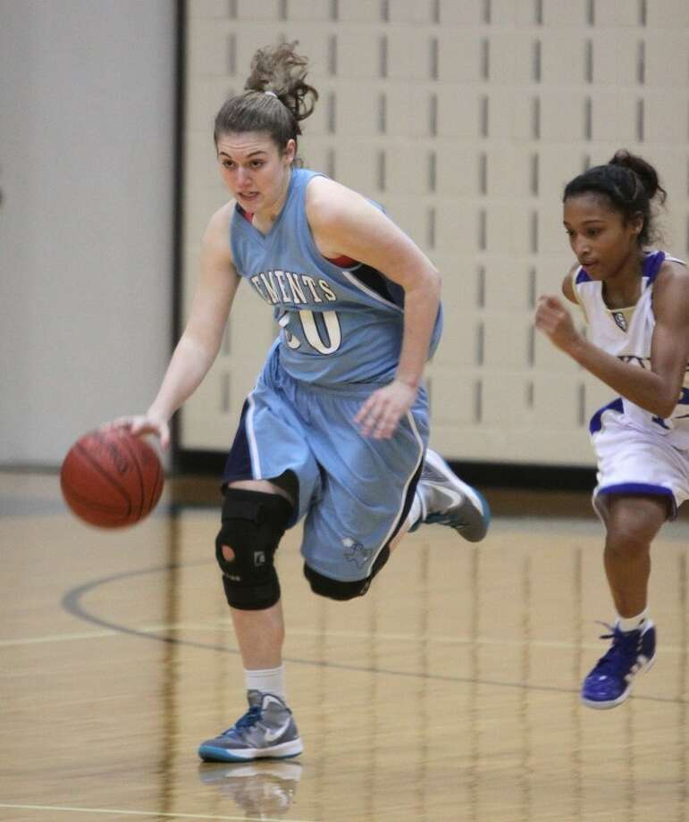 Clements Carly Truesdale brings the ball up court against Elkins Ashle Stokes Friday night at Wheeler Field House. (Alan Warren/HCN) Photo: Alan Warren