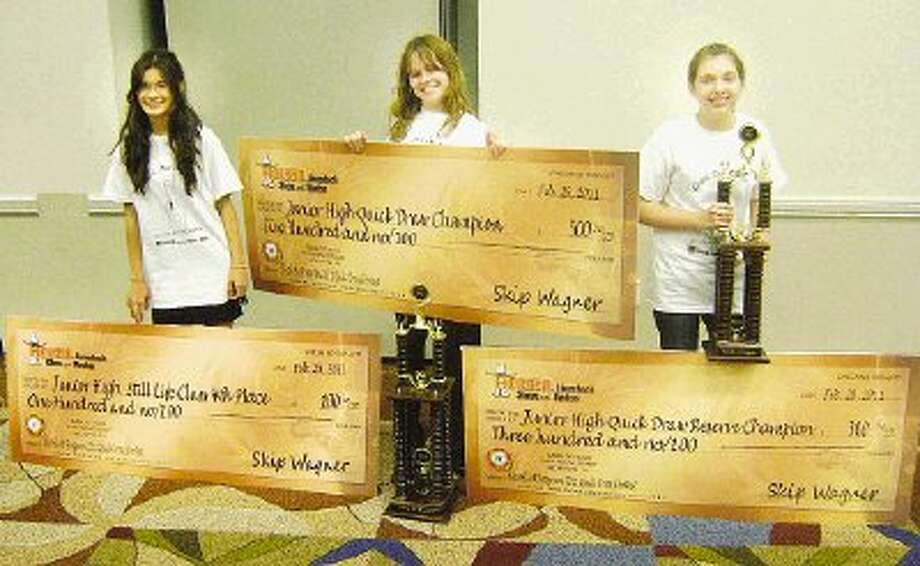 Out of the 26 invited participants, McCullough Junior High had 13 students participate in the fifth annual Quick Draw Contest at the Houston Livestock Show and Rodeo Feb. 26. Pictured, from left, are Sidney Ylagan, 14, who took fourth place prize; Alyssa Drew, 13, who earned reserve champion; and Maddison Authur, 14, who won grand champion. / @WireImgId=2156611