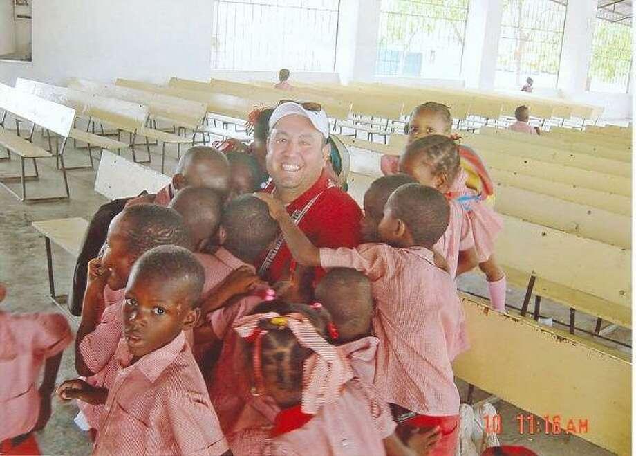 Youth Pastor Ed Villarel spends time with local children in Haiti.