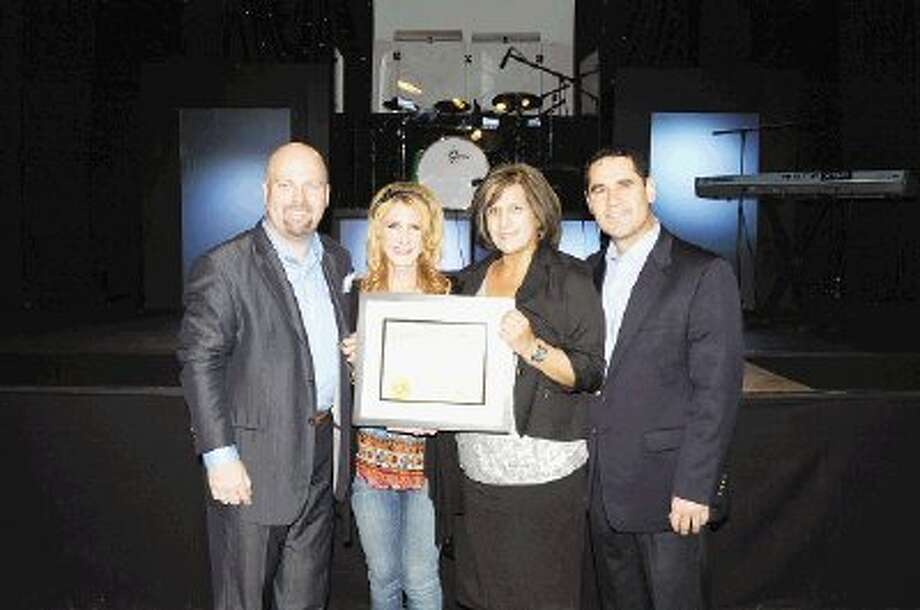 Lead Pastors Matt and Tammy Woodfill recognize new Spanish Pastors Javier and Alejandrina Lopez, all of The Way Church.