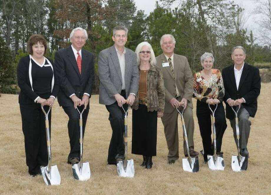 Representatives from four area chambers and other officials were on hand to ceremonially break ground on an overpass that will cross railroad tracks and FM 2854. From left, Carolyn Bruton, chair of the Magnolia Chamber of Commerce; Larry Johnson president of The Johnson Development Corp., Precinct 2 Commissioner Craig Doyal; Diane Holland, president of the Magnolia Parkway Chamber of Commerce; Roy Morton, chair of the Conroe Chamber of Commerce; Kay Hohman, vice president of communications, legislative and economic outlook for the South Montgomery County Woodlands Chamber of Commerce; and Virgil Yoakum, general manager of Woodforest Development. The overpass should take about a year to complete.