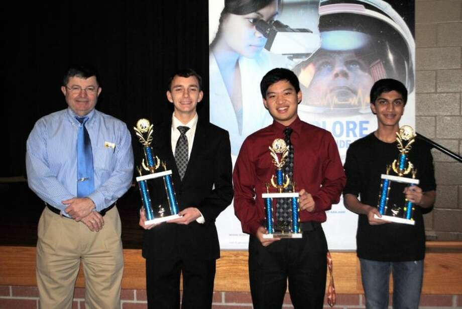 Pictured, (from left) are SAIC Program Manager and former astronaut,  Kenneth D. Cameron,  CCISD Science Fair Grand Award winners Kevin Cyr and runner up winners Allen Hu and Kushal Kadakia. Grand Award winner Perry Alagappan is not pictured.