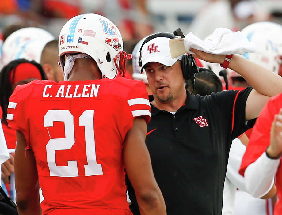 Houston head coach Tom Herman talks to wide receiver Chance Allen (21) as he comes off the field during the second quarter of an NCAA football game against Lamar  at TDECU Stadium on Saturday, Sept. 10, 2016, in Houston. ( Brett Coomer / Houston Chronicle ) Photo: Brett Coomer, Staff / © 2016 Houston Chronicle