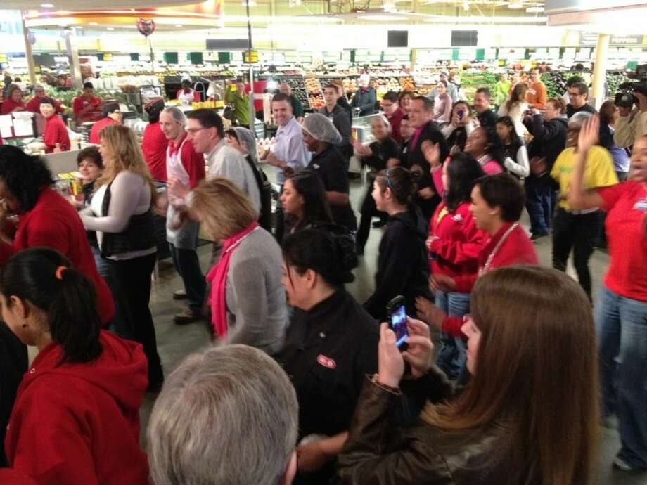 "More than 200 participants in the Houston area got their hearts pumping during this ""dance break"" at H-E-B Bunker Hill Market (pictured) and listened to Dr. James T. Willerson, president and medical director of the Texas Heart Institute, speak about practical ways to beat heart disease. Statewide more than 25,000 H-E-B Partners and customers across Texas simultaneously danced to a healthy beat in support of American Heart Month on Saturday, Feb. 11, at 11 a.m. (Photo submitted by H-E-B)"