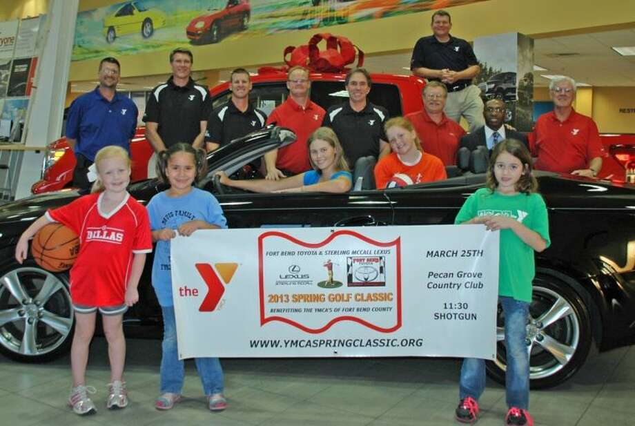 (From Left to Right) Front Row - Sarah Drury, Maggie Ochoa and Lani Hoyt. Seated in Car - Lexi Landoski and Grace Stuart. Behind Car - Brian Haines, Katy Y Executive; Eric Schenkelberg, Fort Bend Y Group Executive; Mike Pede, Y Volunteer; Kevin Drury, Y Volunteer; Bill Myers, Y Golf Chair; Nick Landoski, Fort Bend Toyota & Y Volunteer; Tony Adeola, Sterling McCall Lexus; and Ed Conner, Y Volunteer. In Truck - Jess Stuart, TW Davis Y Executive.