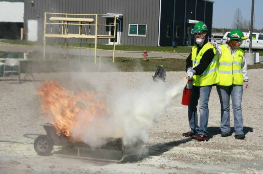 Several CERT team members undergo the fire suppression portion of the sixth annual CERT Rodeo Feb. 11.