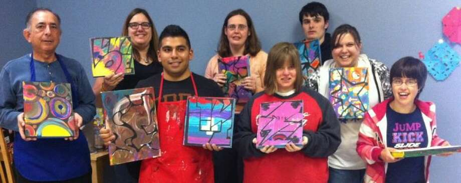 ARTreach students dispaly their artwork. Photo: Submitted