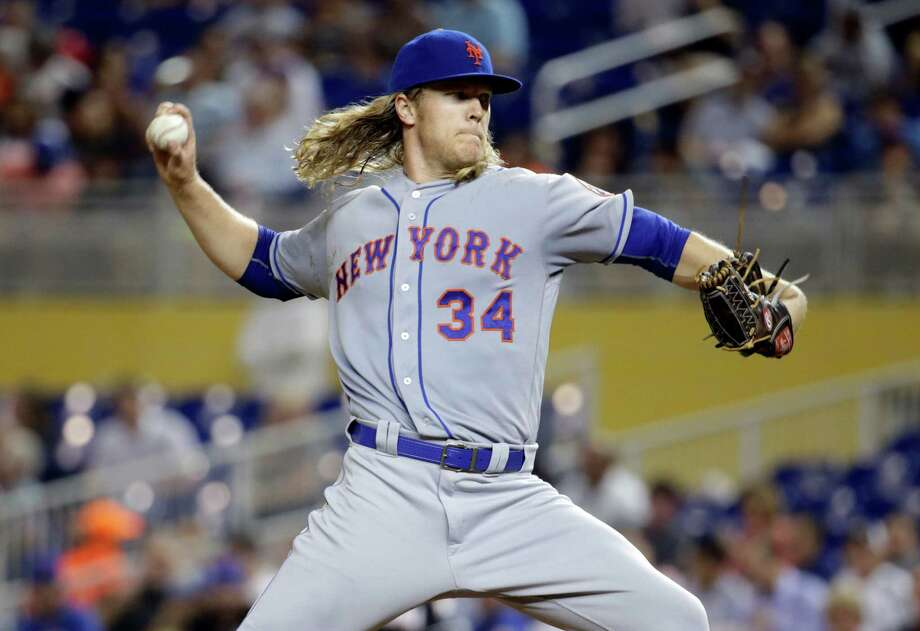 New York Mets starting pitcher Noah Syndergaard (34) throws in the fourth inning during a baseball game against the Miami Marlins, Tuesday, Sept. 27, 2016, in Miami. (AP Photo/Lynne Sladky) ORG XMIT: FLLS114 Photo: Lynne Sladky / Copyright 2016 The Associated Press. All rights reserved.
