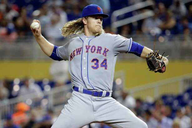 New York Mets starting pitcher Noah Syndergaard (34) throws in the fourth inning during a baseball game against the Miami Marlins, Tuesday, Sept. 27, 2016, in Miami. (AP Photo/Lynne Sladky) ORG XMIT: FLLS114