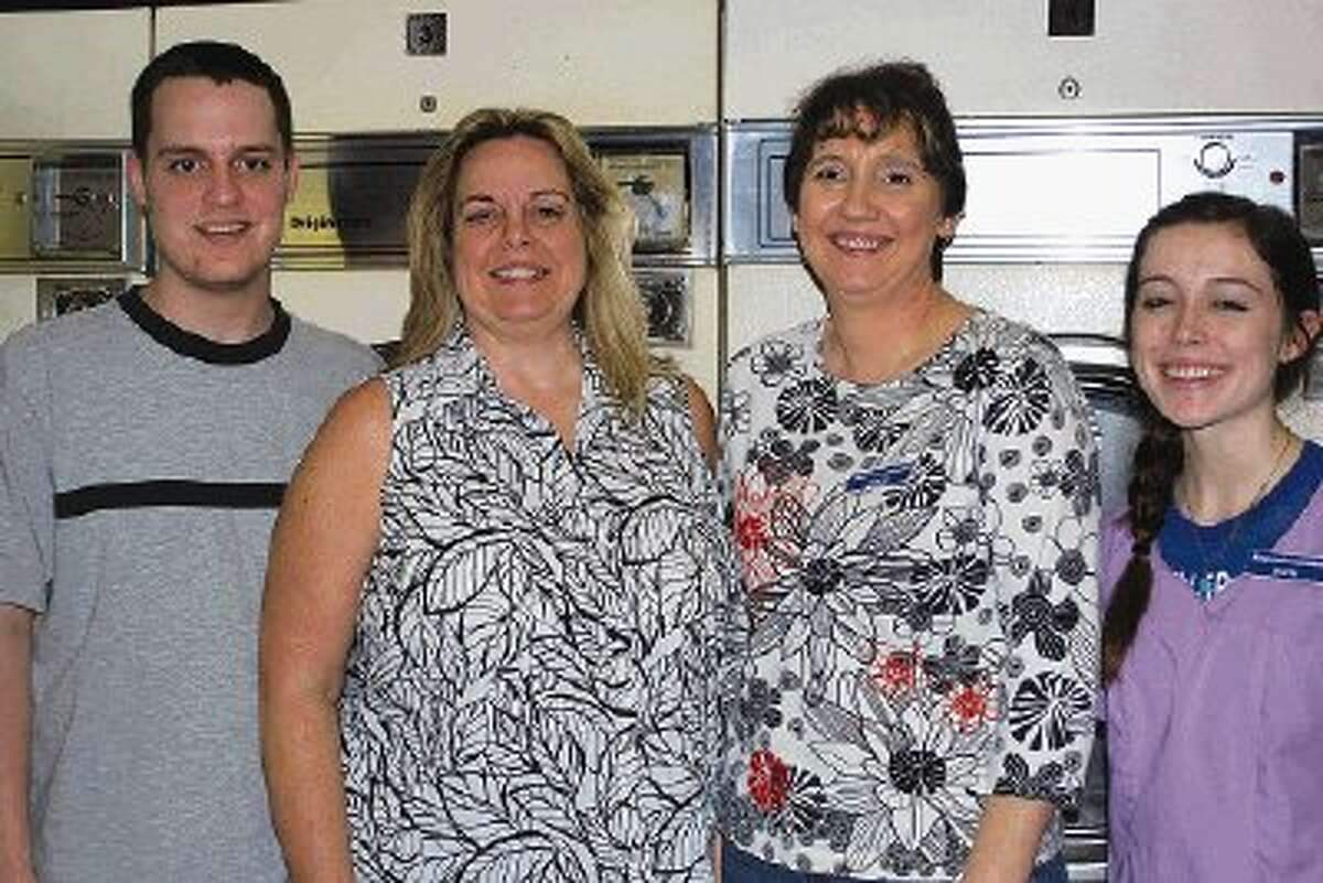 The staff at The Laundromat will welcome the Kingwood Cash Mob and its followers Feb. 20-24. Shown are, from left, Chris Williams and owner Brenda Williams, along with employees Sheryl Abbott and Devin Lee.