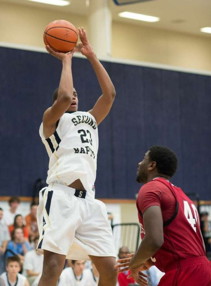 Second Baptist big man Khadeem Lattin puts up a shot during a recent Golden Eagles' victory. The Eagles have clinched a TAPPS playoff spot and ended the regular season Tuesday night at home against Westbury Christian.