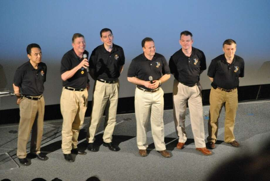 Astronauts Satoshi Furukawa, Mike Fossum, Sergei Volkov, Ron Garan, Alexander Samokutyaev and Andrey Borisenko, from left, answer questions from the audience at Space Center Houston's movie theater.