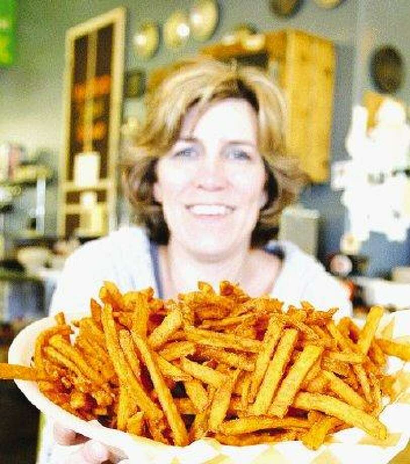 Marlene Stubler, owner of Pie in the Sky in Conroe, shows off her sweet potato fries, one of the restaurants popular sidedishes.