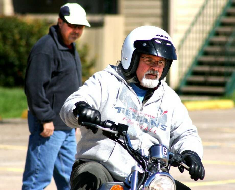 ACC instructor Raymond Ruiz watches student Walter Miller, of Friendswood, make a proper turn during a motorcycle safety course on February 11. Photo: ACC