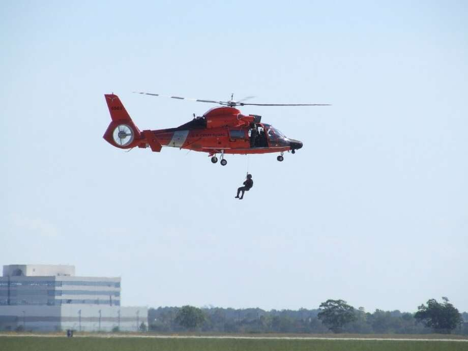 A Coast Guard rescue helicopter like this one shown during the Wings Over Houston airshow in October 2011 was used to save a woman who fell overboard near Kemah Sunday (Feb. 12).