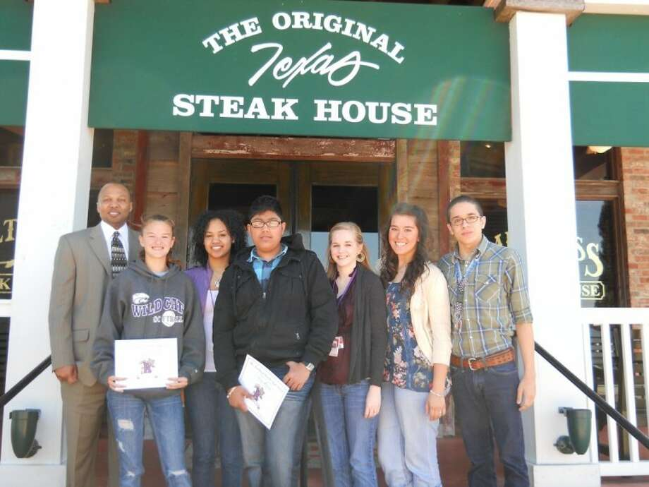 Humble High School principal Charles Ned, enjoys spending lunch with students every six weeks. Pictured from left are the students honored at Saltgrass Steakhouse March 10: Johnna Martone, D'Vasha Davis, Suraj Dalwadi, Kimberly Patterson, Lauren Martinez, Edis Moreno. Not pictured- Jonathon Villa.