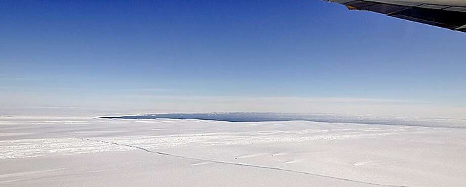 A large, miles-long crack was plainly visible across the ice shelf on the Pine Island Glacier during an overflight by NASA's DC-8 airborne science laboratory Oct. 14, 2011, as part of Operation IceBridge. (NASA / Michael Studinger)