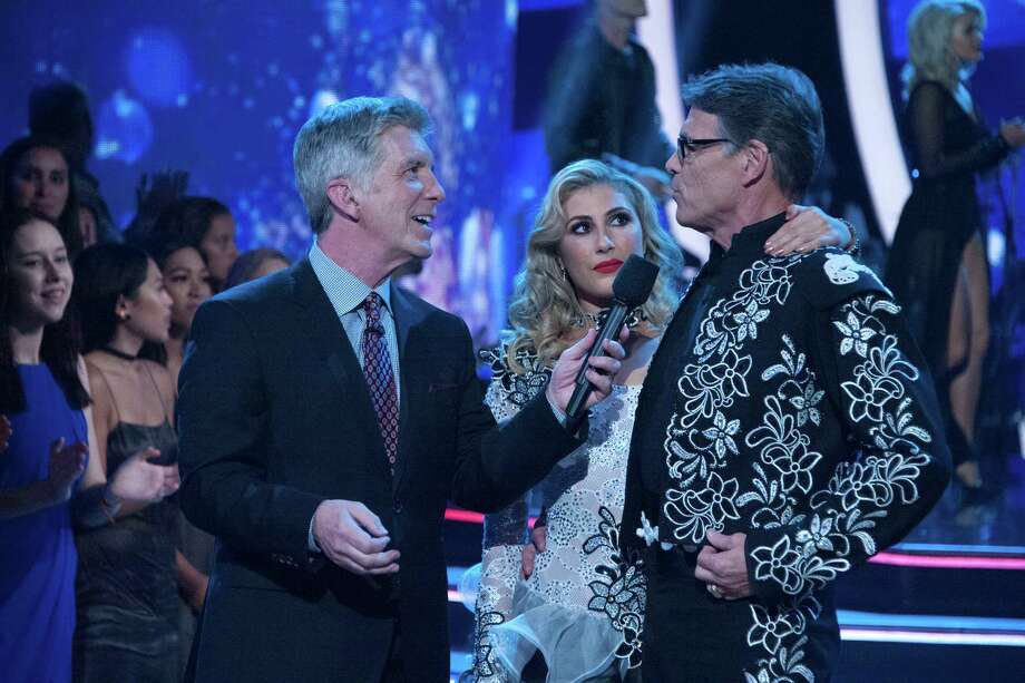 """Former governor of Texas Rick Perry was eliminated from """"Dancing with the Stars"""" Tuesday night. Host Tom Bergeron delivered the news to Perry and dance partner Emma Slater. Photo: ABC /Eric McCandless / © 2016 American Broadcasting Companies, Inc. All rights reserved."""