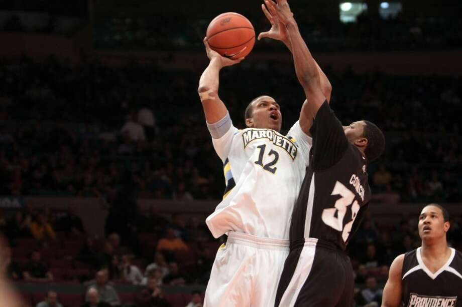 Marquette University sophomore forward Erik Williams, a 2009 Cy Springs High graduate, competed against Providence in the Big East Tournament last week in New York City.