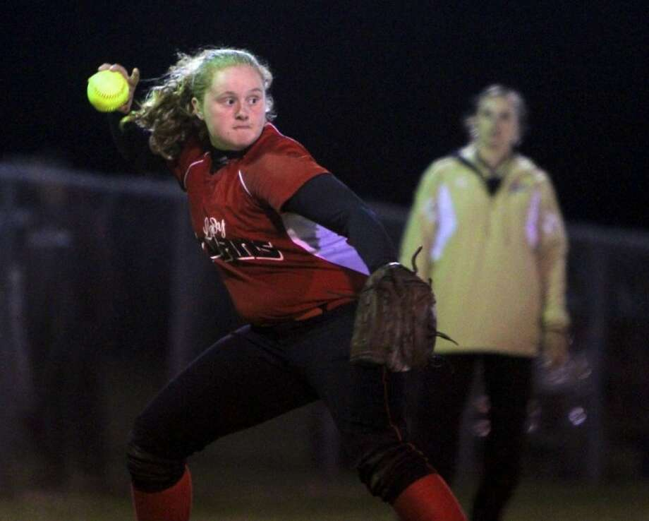 Coldspring third baseman Rebecca Hopson tries to throw out Liberty runner Caroline Moorman during the fourth inning on Friday, March 11. Liberty defeated Coldspring 9-3.