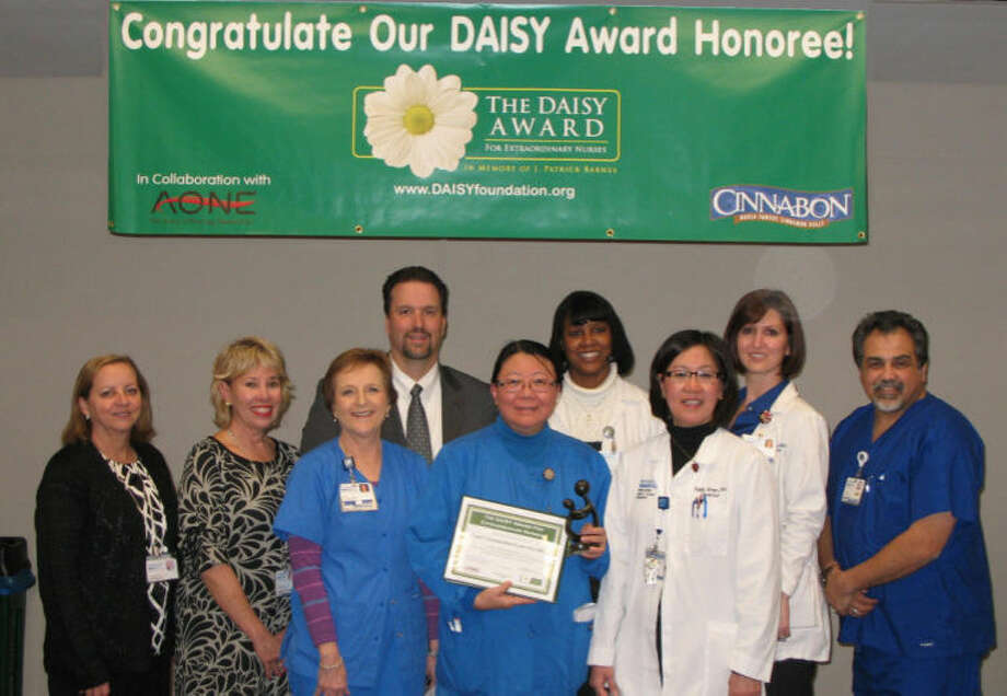 DAISY Award Recipient, Joy Fey, RN, with the DAISY Award Committee. Photo: Submitted Photo