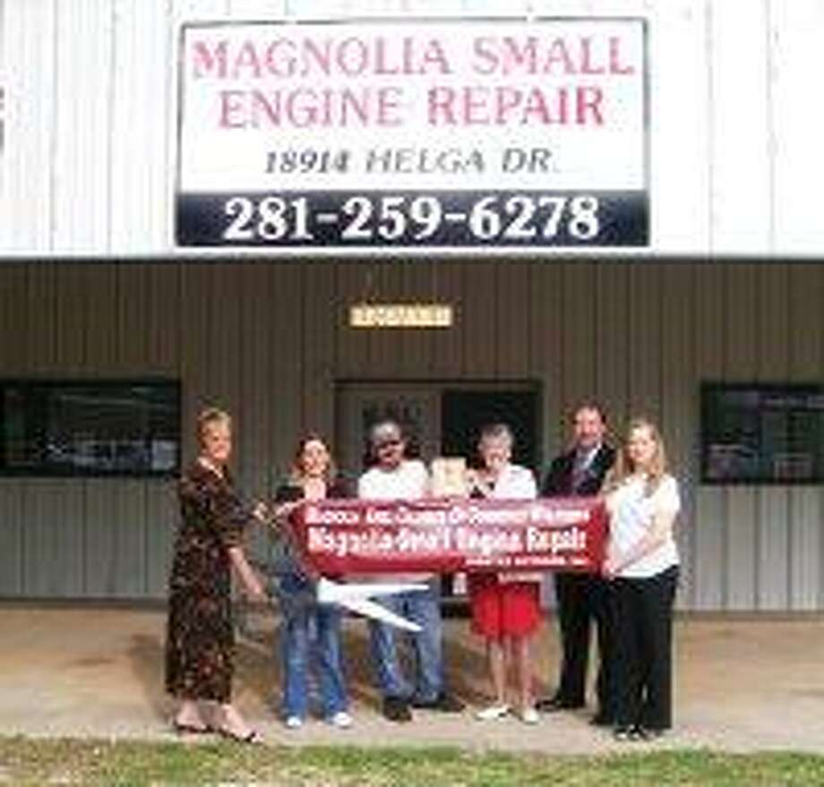 Shane and Wendy Cox recently opened Magnolia Small Engine Repair. Cox has extensive experiences in all forms of small engine repair, including motorcycles. The business is located on Helga Street in Magnolia behind Regions Bank. Shane Cox is pictured receiving the membership plaque from Ambassador Peggy Countryman of the Magnolia Area Chamber of Commerce, a business networking organization. / @WireImgId=258196