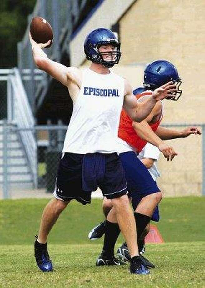 Episcopal quarterback Shane Carden fires a pass while his linemen holds their positions during a recent spring football workout.