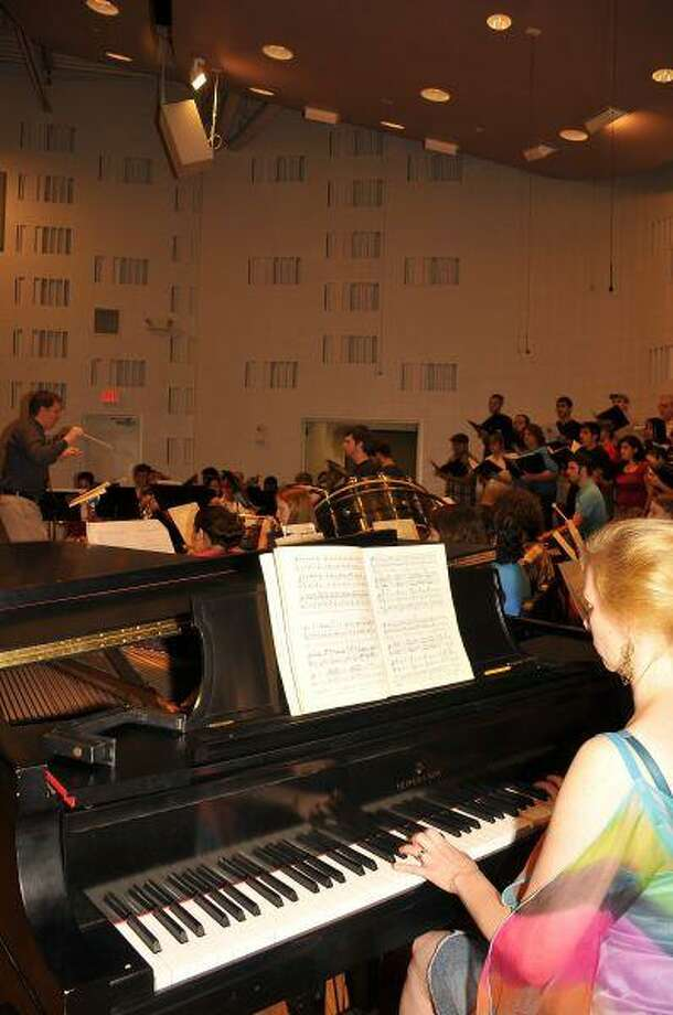 "The Chamber Winds and College Chorale at San Jacinto College Central rehearse a piece from their upcoming performance of ""Carmina Burana."" Music professor Sarah Spencer practices her part on piano as Dr. Paul Busselberg conducts the ensemble."