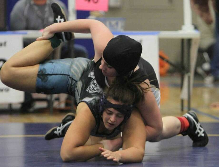 Conroe's Rebecka Winton, top, won the District 9-5A title at 215 pounds last week. She is 14-3 this season.