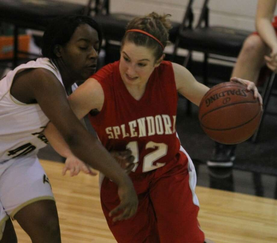 Jordan Ellison (24) of Splendora goes up against Jailyn Semien (22) of Liberty during the girls basketball game at Liberty High School on Feb. 3. Liberty upset Splendora 51-29.