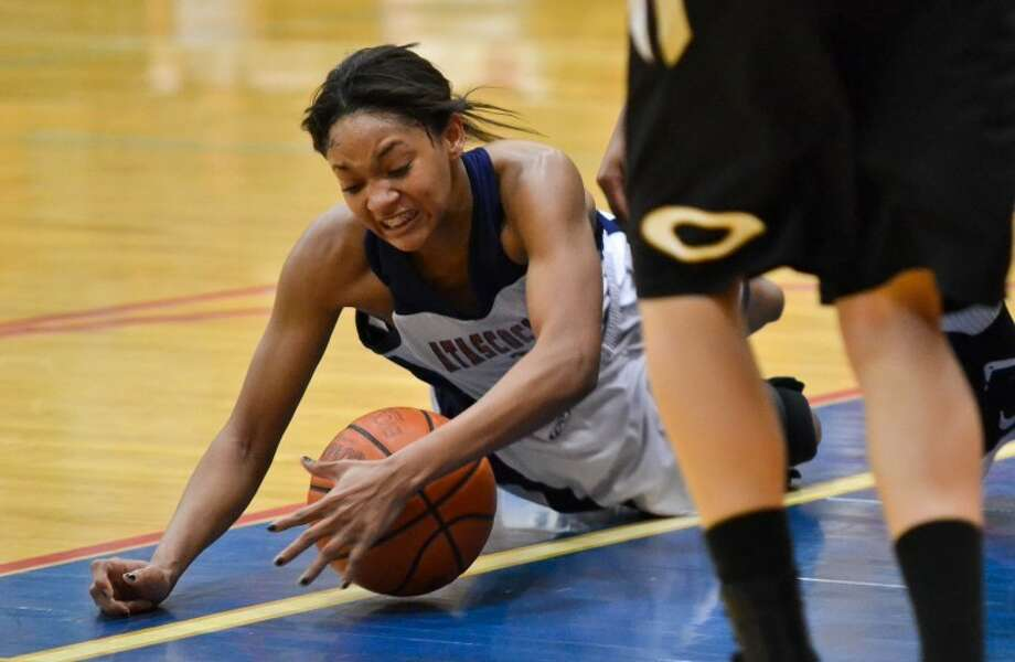 Atascocita guard Curtyce Knox dives for a loose ball in the third quarter of the Lady Eagles' 67-60 bi-district playoff win over Klein Oak Feb. 13. Photo: Photo By Stephen Whitfield