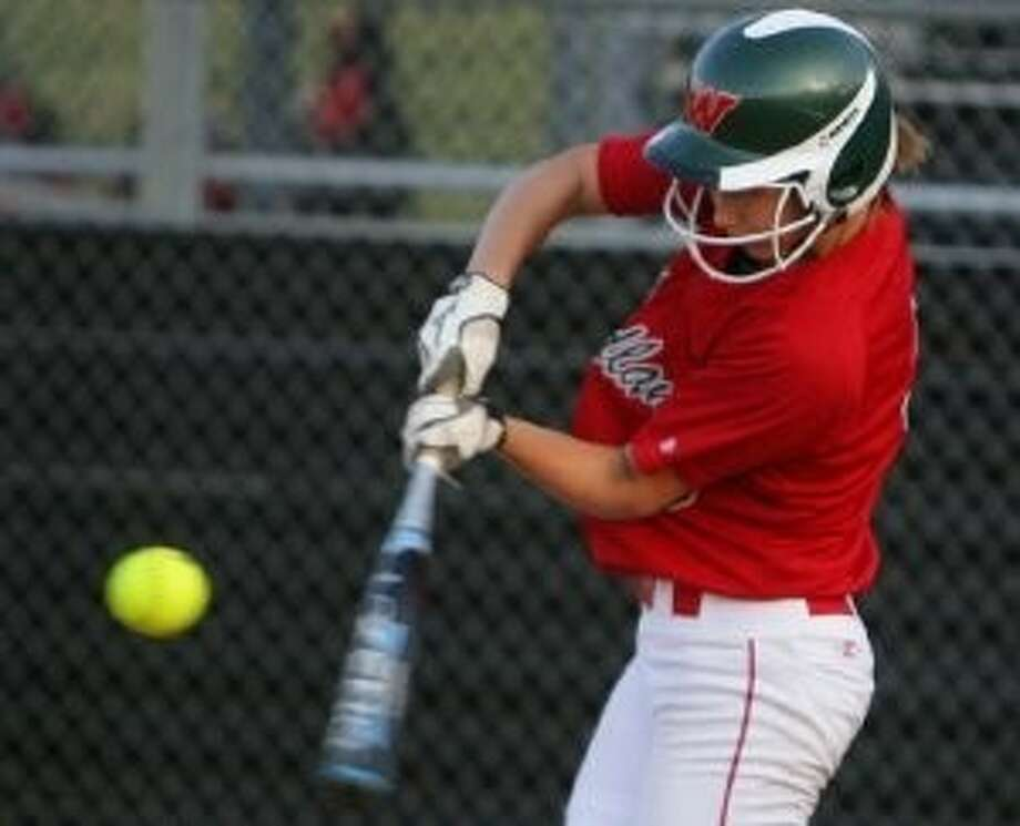 The Woodlands' Abby Langkamp bats during a district game against Conroe last season.