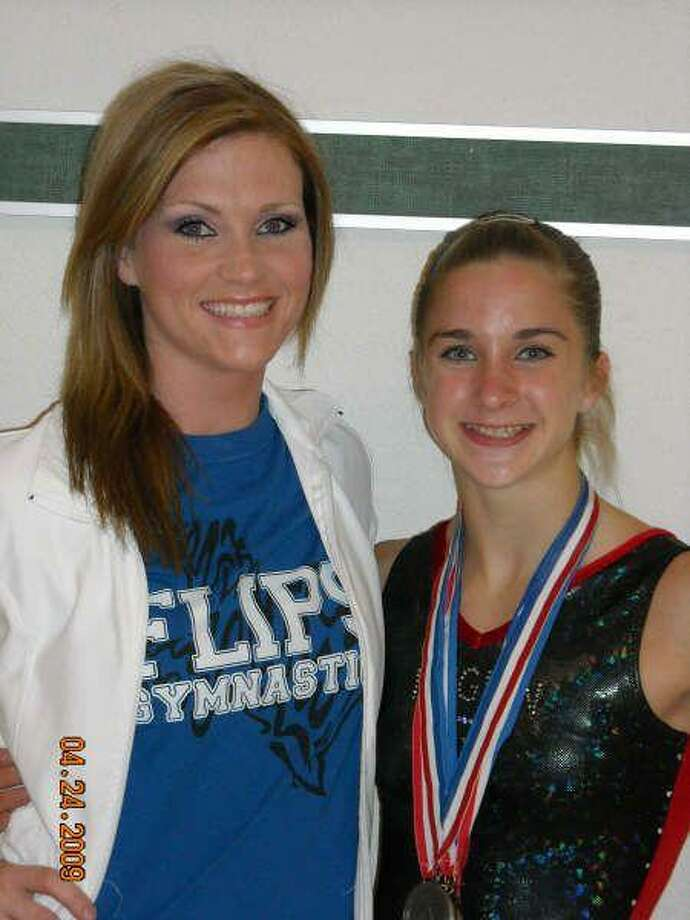 Katie Hansen, right, recently won the floor exercise and placed second in the all-around competition at the USA Gymnastics Region III meet in Norman, Okla. Also pictured Is Hansen's coach, Gretchen Richter.