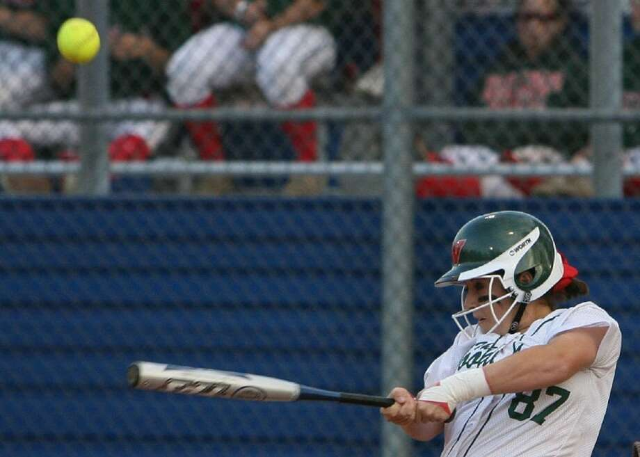 The Woodlands' Jessica Snyder takes a swing during Tuesday night's game against Oak Ridge.