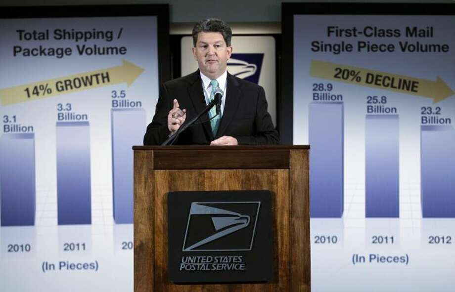 Postmaster General and CEO Patrick R. Donahoe speaks during a news conference at U.S. Postal Service headquarters on Wednesday in Washington. The financially struggling U.S. Postal Service says it will stop delivering mail on Saturdays but continue to disburse packages six days a week.