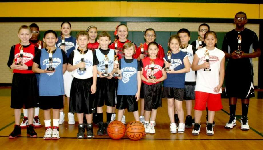 """The """"Sweet Sixteen"""" from last Saturday's 11th annual Super Swish free-throw competition pose with their trophies. The competitors from the city's Parks & Rec youth basketball league broke one record and tied another. For more on the event, see What's Happening. Photo: Robert Avery"""