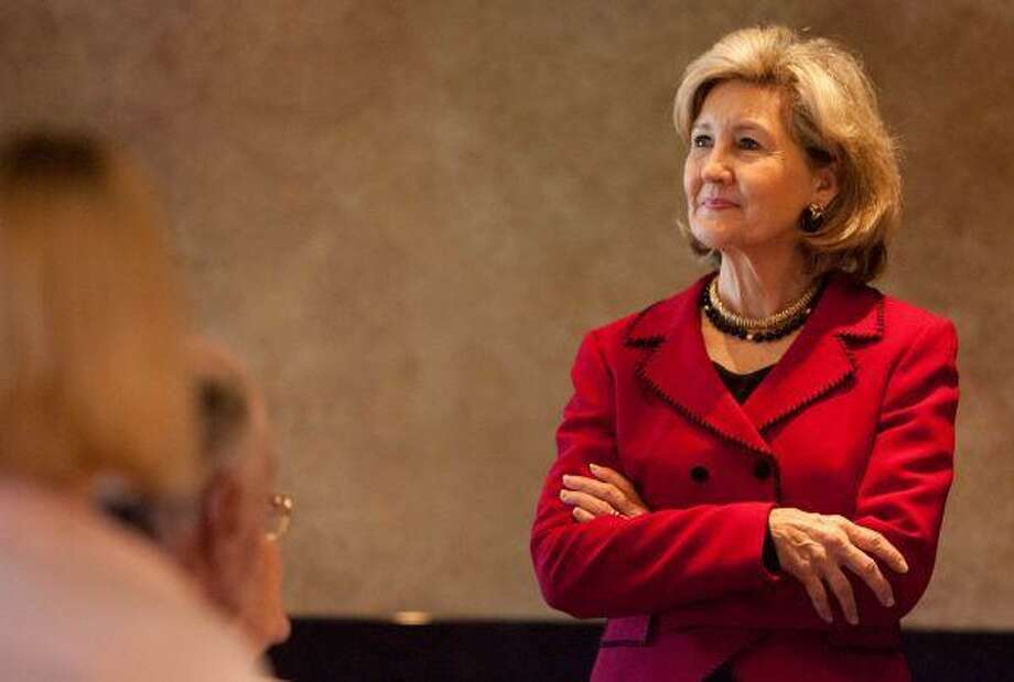 U.S. Sen. and gubernatorial candidate Kay Bailey Hutchison, R-Texas, listens as a supporter asks a question during a campaign mixer Friday at Amerigo's Grille. Hutchison faces Gov. Rick Perry and Debra Medina in the March 2 Republican primary. / The Courier