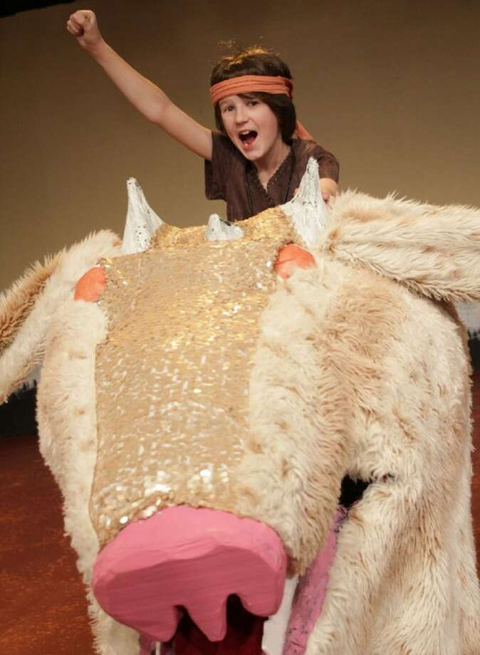 "Pictured is Atreyu riding Falkor (with Marshall White as Atreyu; puppet design by Art Ornelas). 17 Houston area children will perform in Main Street Theater's production of ""The Neverending Stor"" on Feb. 17 - 19 at Main Street Theater - Chelsea Market, located at 4617 Montrose Blvd. For more information, call 713.524.6706 or visit www.mainstreettheater.com. (Photo by www.RicOrnelProductions.com, submitted by Main Street Theater)"