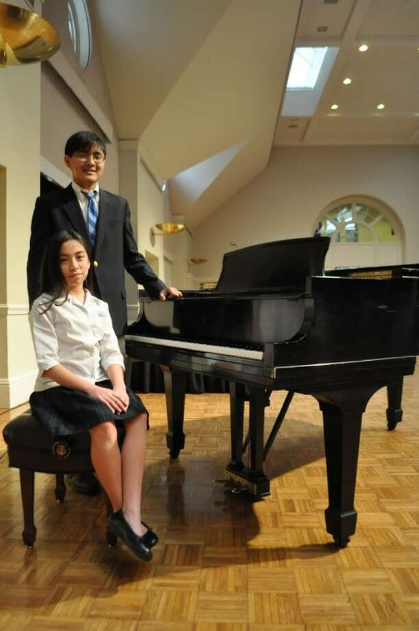 Pictured Presbyterian Middle School students, fifth-grader Vi Nguyen (sitting) and eighth-grader Joyson Zhang (standing) who will perform at Carnegie Hall this Spring as a result of national music competition wins. (Photo submitted by Presbyterian School)