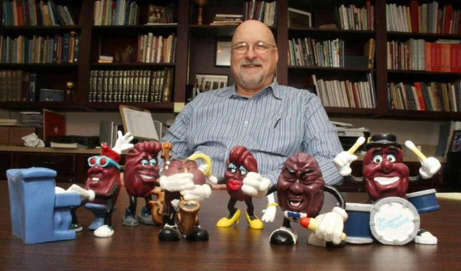 In addition to his collection of musical instruments from around the world, Tim Holder has an ongoing collection of the California Raisins. After receiving the singer, second from right, as a gift 25 years ago, the worship pastor at First Baptist Church has been on a search for the rest of the members of the grapevine gang. Photo: JASON FOCHTMAN