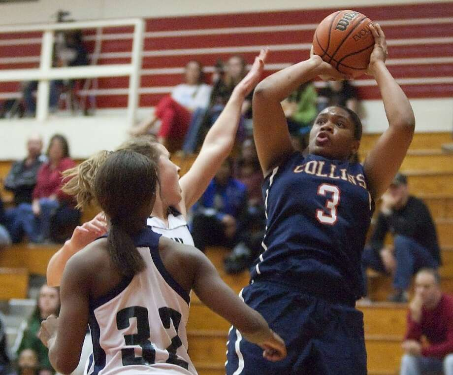 Klein Collins' Veja Hamilton shoots under pressure from College Park Tuesday in a Region II-5A girls basketball playoff game at Tomball High School. See more photos online at www.yourconroenews.com/photos. Photo: Karl Anderson