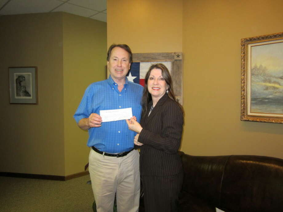 James McClellan, president of the Fred and Mabel R. Parks Foundation, presents Diane Pavey, director of major gifts at Girl Scouts of San Jacinto Council (GSSJC), with a $10,100 grant to support Girl Scouting in the School Day (GSISD) in the Fort Bend. GSISD is offered free-of-charge to girls during and after school for 27 weeks each year. With GSISD, GSSJC hopes to reach approximately 1,000 girls who want to be Girl Scouts but lack the financial resources and parental involvement to do so.